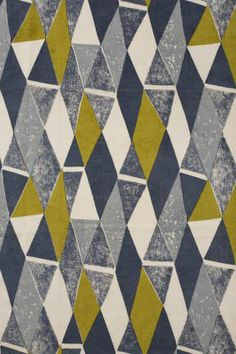 Length of linen fabric printed with a geometric design in lime green, black, slate grey and light grey abstract on a white ground, made in England c.1950-1960