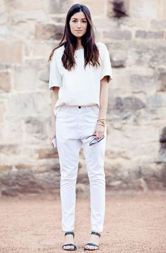 White tee, loose white jeans and black strappy sandals