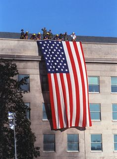 Flag draped from top of the Pentagon after terrorist attack on September It shouted to the world. Us History, American History, History Education, Large American Flag, American Pride, American Quotes, American Symbols, American Women, American Indians