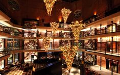 Six decked-out Christmas trees hang upside-down from the ceiling of the Liberty's 90-foot rotunda. The attention-grabbing installation required workers to dangle from safety harnesses as they affixed the trees to the ceiling's lofty rafters. It's an inspired new spin on holiday décor—and appropriate for a building that did a 180 of its own by transforming from a jail into a luxury hotel.