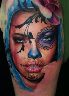 So much talent. Catrina Tattoo. Day of the Dead. Beautiful. Pink Rose. Blue Eyes. Purple. Yellow. Stitched lips.