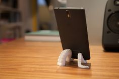 Version three of Notcolinforreal's Octopus Stand works with the iPhone 6/6 Plus, iPad Air, and a slew of Android devices. It might even work if you're using a case. But there's only one way to find out! http://thingiverse.com/thing:607518