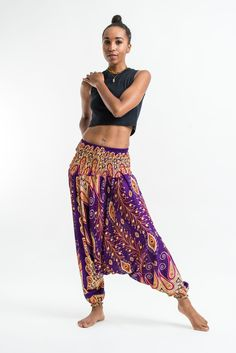 These magical Low Cut Harem Pants can be converted into a jumpsuit.Cotton/Rayon Blend. It's like buying one outfit but getting two. They are great for lazy Sundays, doing yoga, or hula hooping at a mu
