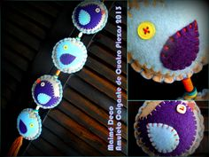 Amuleto Colgante de Cuatro Piezas, de 55 cm de largo. Materiales: Pañolenci, Botones Heredados, Hilos de Bordar y Lana; relleno de Vellón Siliconado. Colores: Celeste, Violeta, Beige y Naranja; Botoncitos en Corazones, color Amarillo.