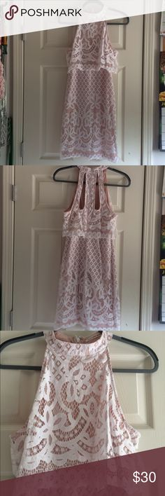 Beautiful White Lace Dress Used once for a wedding rehearsal.  This dress is beautiful on.  Nude underlay with white lace overlay.  High collared neck.  Appears as a two piece, but is one.  Has back zipper.  Cut out detail on back. Mustard Seed Dresses Midi