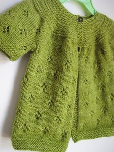 Sweet baby sweater pattern - free on Ravelry.. Green with pattern & round yolk neckline.