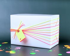 Cool diy gift wrapping idea with neon strings