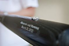 Custom engraved Louisville Slugger Wedding Bat ... get up to four lines of text.  Order today at SportsThemedWeddings.com