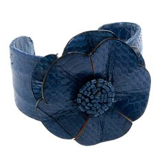 A unique design adds style to this base metal flower cuff bracelet. Crafted of base metal, this cute bracelet features a polished finish. Brand: Kele and Co Style: Cuff Color: Blue Materials: Leather