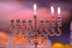 Thanksgivukkah Day 2-The Chanukiah Candles by Wayne Wong on Capture Kern County // The Chanukiah has one tall candle holder flanked by four lower holders at the same level on each side for a total of 8 candles at the same level.