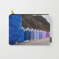 Organize your life with our Carry-All Pouches - perfect for toiletries, art supplies, makeup and smaller electronics. Pouches are available in three sizes, with the large able to fit an iPad.      - Available in three sizes   - Also available in set of 3, which includes all sizes   - Durable, canvas-like exterior    - Soft 50/50 poly-cotton black interior lining    - Faux leather pull tab   - Machine washable