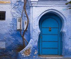 Blue door in blue wall