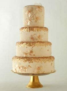 Beautiful gold and flower petals cake.