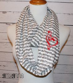 Fabric: Sheet Music Style: Infinity Scarf Embroidery: Red Thread Treble/Bass Clef Heart    This scarf is great. Its perfect to buy for yourself..
