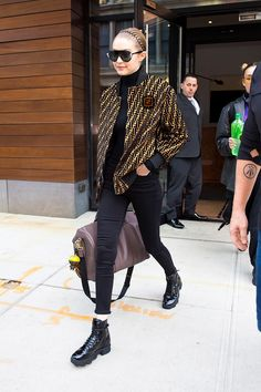 February 20, 2018 Hadid left her NYC apartment for Milan Fashion Week in a double dose of Fendi. She wore the label's logo-covered bomber jacket and matched it to the luggage strap of her duffle bag.
