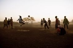 Photograph by David Chancellor @chancellordavid  the sun sets on a football match on the outskirts of Mabopane township, South Africa. From work and projects documenting community conservation #withbutterfliesandwarriors  Its impossible to conserve if we don't allow communities to share in the benefits, and decisions taken regarding the wildlife with which they share their land and live in proximity of..To see more of my work and projects on this subject follow me at @chancellordavid and…