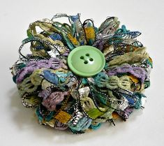 made using two types of novelty yarn about cm across with silver-tone pinback with centre vintage button Cloth Flowers, Felt Flowers, Diy Flowers, Crochet Flowers, Fabric Flowers, Ribbon Crafts, Flower Crafts, Fabric Crafts, Sewing Crafts