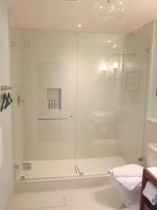 Custom Frameless Shower Door And Fixed Panel Installation With A Portals Towel Bar