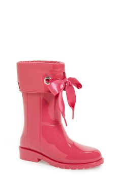 Making the little one puddle-proof with these adorable rainboots in pink with a bow detail for an extra girly touch.