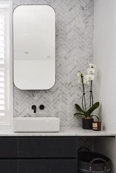The hits and misses of ensuite reveals from The Block Rectangular mirrored shaving cabinets with rounded edges and sleek black frame in bathroom. Feature herringbone marble tile wall in bathroom Simple Bathroom, Master Bathroom, Bathroom Black, Bathroom Marble, Bathroom Cabinets, Marble Wall, Bathroom Feature Wall Tile, The Block Bathroom, Tiled Walls In Bathroom