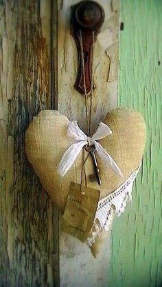Vintage  key on a stuffed heart