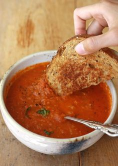 Homemade tomato basil soup perfect to dip your grilled cheese sandwich in.