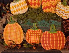 "Trendy Pumpkin Trio, Plaid - Asst. 3 The stakes can be used as a stake or hung with attached hanger. Item: F7049 Hang/Stake Measures: Small: 9"" x .5"" x 8"" Tall: 12.5"" x .5"" x 9"" Large: 11.5"" x .5"" x 1"