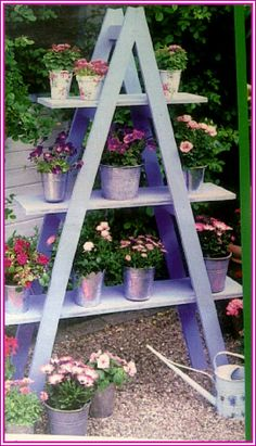 Cute idea. Paint wooden planks and a ladder and set up as a little garden/deck decor.