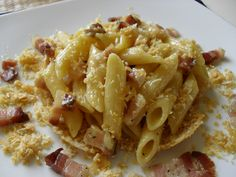 penne with bacon and pan cooked grated parmiggiano.... the taste is like smoky cheese aged, rare thing!