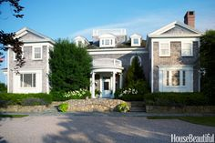 The entrance facade of the Colonial Revival house in Watch Hill, Rhode Island, designed by architect Robert Rich, commands a seaside bluff. Interior design by Tom Scheerer. More: 8 Dream Designer Closets   - HouseBeautiful.com