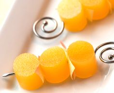 Mimosa Jello Shots: These are made with champagne and orange juice, and cut with an oval cookie cutter.