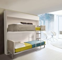 Lollisoft IN Bunk Bed System....the beds fold up and out of sight leaving a blank wall in their place.