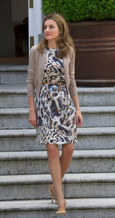 April 25, 2011: Princess Letizia attends a lunch at El Pardo Palace in Madrid, Spain in an animal print dress and beige cardi. She topped off the look with a subtle nude belt and heels.