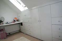 attic-Fitted Wardrobes - Fitted Wardrobes in London, Bookshelves, Bespoke furniture, custom Bookcases, floating shelves, shelving, Made to measure MDF cabinets, built in bookcases