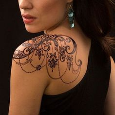 Awesome Looking Shoulder Tattoo Ideas Shoulder Accessory Tattoo Design: Flying Sparrows Shoulder Tattoo: Peacock Design Shoulder Tattoo: Lace Tattoo For Shoulder: Shoulder Heena Tattoo Design: Shoulder Flower Tattoo Design: Tribal Style Shoulder Tattoo: Moon and Star Tattoo Design: Text Shoulder Tattoo Design: Beautiful Sparrows Design Tattoo: Flower Shoulder Tattoo Design: