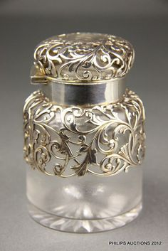 An antique American sterling silver-mounted glass scent bottle,… - Scent Bottles - Costume & Dressing Accessories - Carter's Price Guide to Antiques and Collectables