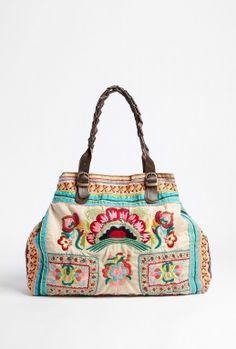 Very pretty.  Star Mela | Kalaya Embroidered Ecru Bag by Star Mela $220
