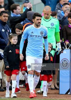 <a gi-track='captionPersonalityLinkClicked' href=/galleries/search?phrase=David+Villa&family=editorial&specificpeople=467566 ng-click='$event.stopPropagation()'>David Villa</a> #7 of New York City FC leads the team out before the start of the game against the New England Revolution during the inaugural game of the New York City FC at Yankee Stadium on March 15, 2015 in the Bronx borough of New York City.