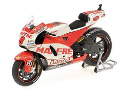 Minichamps 1:12 Ducati Desmosedici Diecast Model Motorcycle 123110008 This Ducati Desmosedici (Hector Barbera - Qatar MotoGP 2011) Diecast Model Motorcycle is Red and White and features working paddock stand, steering, wheels. It is made by Minichamps and is 1:12 scale (approx. 17cm / 6.7in long).    #Minichamps #ModelMotorbike #Ducati