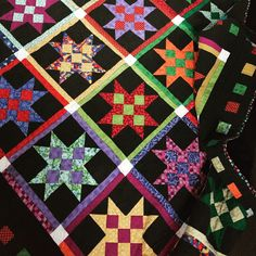 lovely scrappy 9 patch stars quilt, made by suz, from the patchwork 'n' play blog