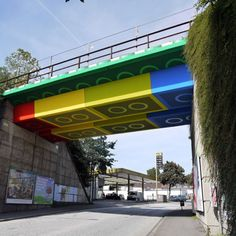LEGO Bridge By MEGX - Martin Heuwold - German artist, Martin Heuwold, aka Megx, used colored panels to transform this bridge into a vibrant Lego brick overpass. The bridge is part of debunk train line that was converted in to bicycle and pedestrian path located in Wuppertal, Germany...