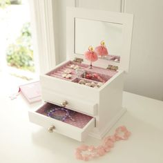 Polka Musical Jewellery Box - A tasteful home for trinkets and treasures. This gorgeous jewellery box plays the Sugar Plum Fairy tune. Features: spinning ballerina, safety mirror, spotty lining and one opening drawer.