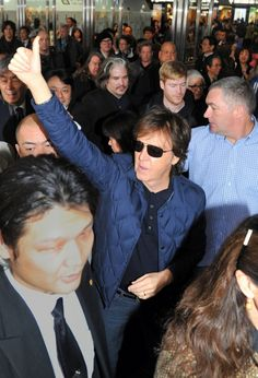 Did you hear about the upcoming Beatles GRAMMY special? It's Macca-approved. #PaulMcCartney offers a thumbs-up to fans at #HakataStation in Fukuokoa, Japan on Nov. 14, 2013