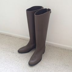 NWOT J.Crew Riding boots Sz 7.5 Olive J.crew riding boots Sz 7.5 Color Olive. Length 16.15 inch(41cm). Never been worn no tags. Like new!! There's a very tiny fold lines and a scratch by the toe, (see the forth photo) it's really nothing. Open to reasonable offer :) J. Crew Shoes Winter & Rain Boots