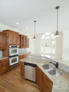 #Kitchen Idea of the Day: Golden-brown kitchen with bi-level kitchen island