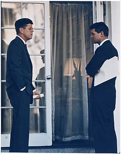 Kennedy speaking with his brother, Attorney General Robert Kennedy at the White House, outside an Oval Office doorway. | 26 Flawless Photos Of John F. Kennedy