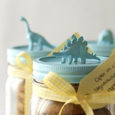Chocosaurus Rex. Paint the dinosaurs and glue them to the top of the jar.