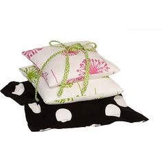 This three pack of decorative pillows are sure to make your little one's nursery warm and cozy. This set features one polka dot, one pink, and one green pillow.