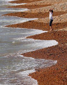 A young boy enjoys the sunshine on Brighton's beach, southern England  (AP Photo / Gareth Fuller, PA)