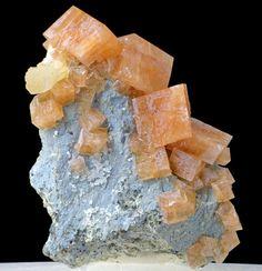 Chabazite-Ca, Stilbite. Imilchil, High Atlas Mts, Morocco. Specimen of sharp chabazite-Ca crystals in oragne/pink color with cream stilbite on matrix.